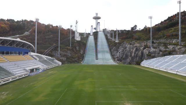 hills stand at the alpensia ski jumping stadium the venue for ski jumping events at the 2018 pyeongchang winter olympic games in pyeongchang gangwon... - ski jumping stock videos and b-roll footage