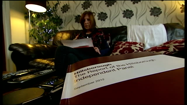 hillsborough campaigner anne williams dies of cancer; t13091218 / tx 13.9.2012 liverpool: int williams with copy of independent report into... - report produced segment stock videos & royalty-free footage