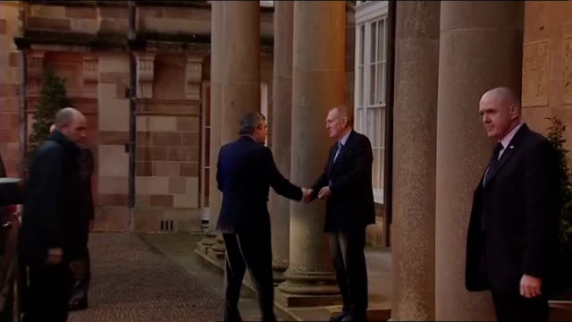 hillsborough castle ext long shot gordon brown mp and brian cowen out of car on arrival for talks and greeted as enter building - gordon brown stock videos & royalty-free footage
