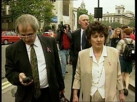 ceen itn england london ext families of hillsborough victims holding embroidered quilt with names of the victims on it een - bedclothes stock videos & royalty-free footage