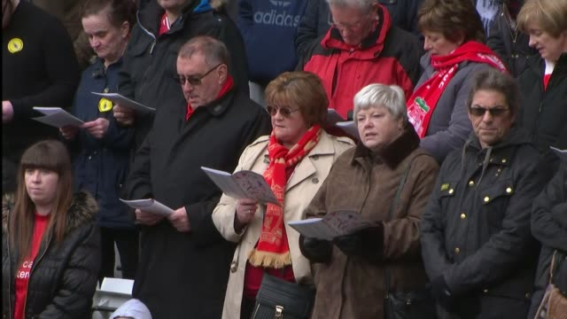 Final Anfield memorial service held ENGLAND Merseyside Liverpool Anfield Stadium EXT Wide shot of crowd congregation at 27th and final Hillsborough...