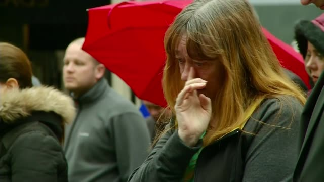 final anfield memorial service held people standing to observe minute's silence in city centre square/ woman wipes tear from her eye as standing for... - memorial event stock videos and b-roll footage