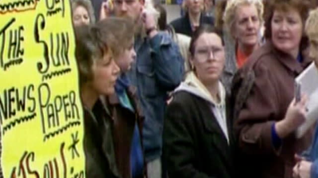 hillsborough disaster: independent report reveals police cover up; date unknown liverpool: ext protest at reporting by the sun newspaper, ripped up... - report produced segment stock videos & royalty-free footage