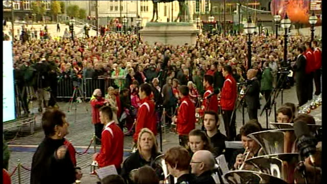 independent report reveals police cover up england liverpool ext crowd gathered at vigil singing 'abide with me' sot pull out band playing liverpool... - neckwear stock videos and b-roll footage