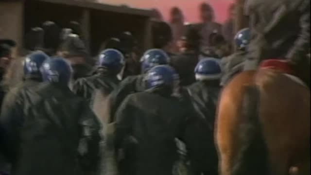 South Yorkshire Police faces lawsuit from families of victims AS290584004 2951984 Yorkshire Orgreave EXT Riot police rush at pickets as smoke bombs...