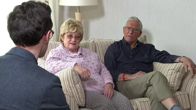 South Yorkshire Police faces lawsuit from families of victims ENGLAND INT ITN reporter sitting chatting with Gloria and Brian Benson in living room...