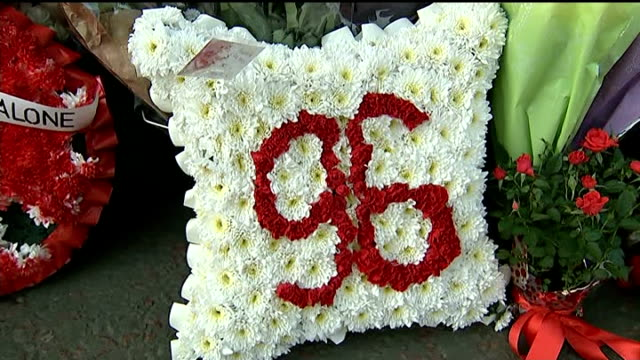 twentyfifth anniversary memorial service '96' floral tribute amongst other flowers banner draped on stadium fence in memory of hillsborough and ibrox... - memorial event stock videos and b-roll footage