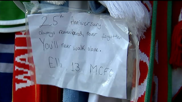 twentyfifth anniversary memorial service handwritten not on scarves hung outside stadium football scarves and shirts hung on fence outside stadium... - neckwear stock videos and b-roll footage