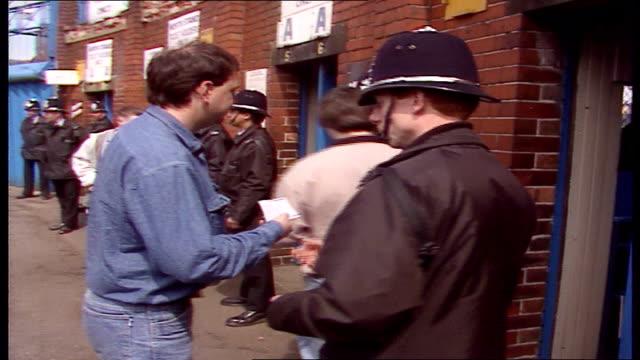 vídeos y material grabado en eventos de stock de stadium reopens england yorkshire sheffield hillsborough ext mounted police outside gates of stadium police looking at tickets and letting people... - ceremonia de reapertura