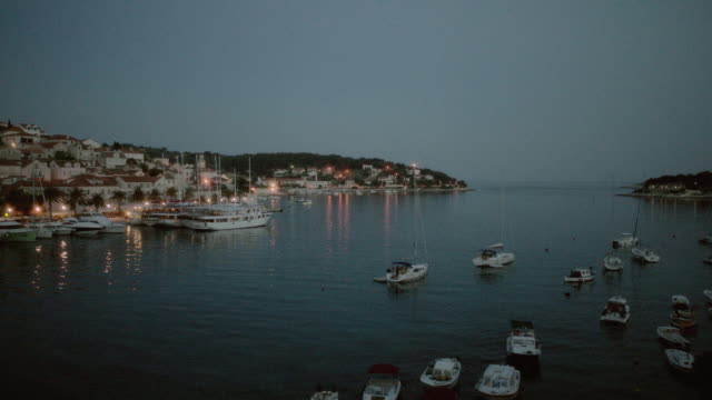 WS A hillside marina at dusk as the ocean blends in with the horizon / Istanbul, Turkey
