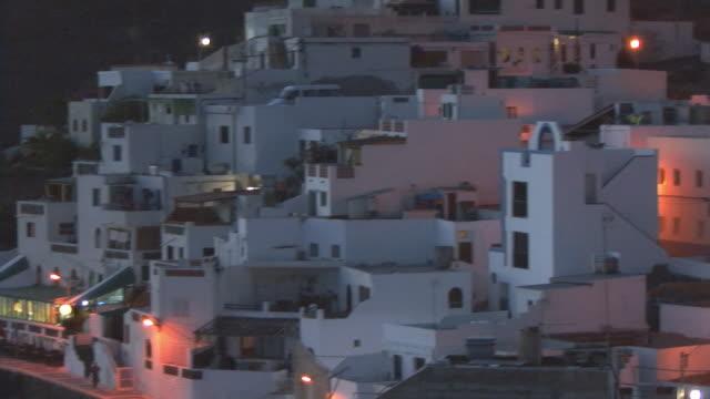 MS, PAN, hillside village by beach at dusk / Las Playitas, Fuerteventura, Canary Islands, Spain