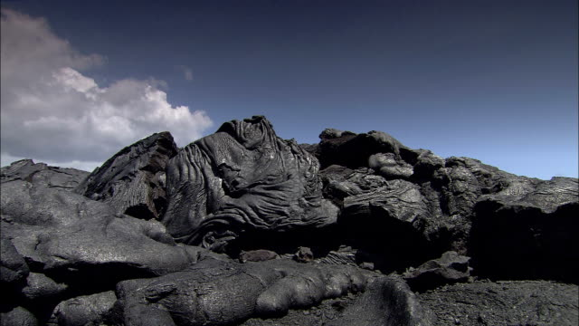a hilltop lava fold has unusual ripples. - folded stock videos & royalty-free footage