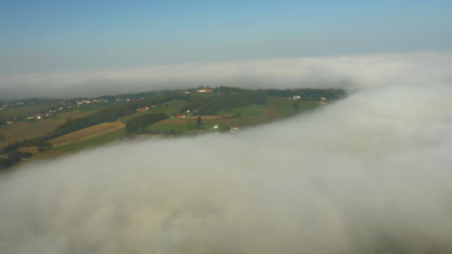 aerial hilly countryside in the fog - prekmurje stock videos & royalty-free footage
