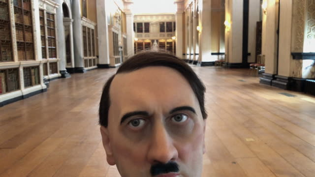 vidéos et rushes de him a realistic model of a kneeling schoolboy with the head of adolf hitler created by artist maurizio cattelan is seen at blenheim palace on... - adolf hitler