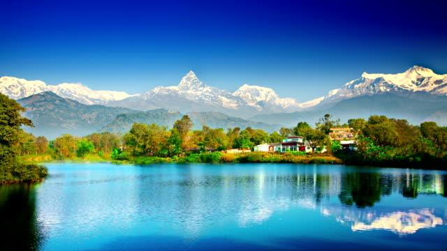 stockvideo's en b-roll-footage met himalaya mountains and lake - annapurna range