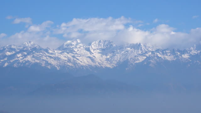himalaya mountains on clouds - nepal stock videos & royalty-free footage