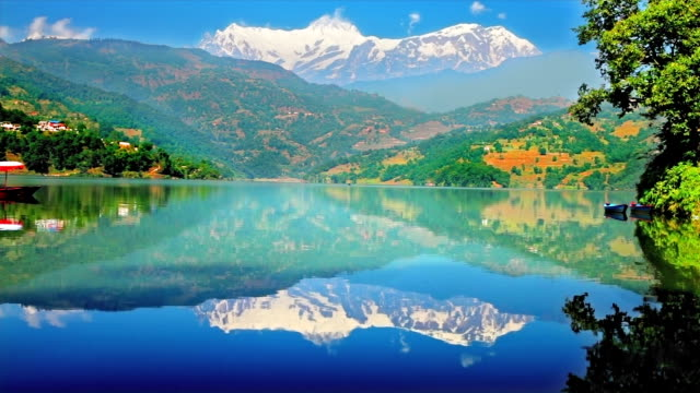 himalaya mountains reflection in lake - annapurna range stock videos and b-roll footage
