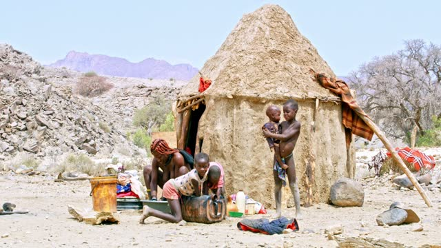 himba children outside sunny hut, namibia, africa. real time. shot in 8k resolution. - 30 seconds or greater stock videos & royalty-free footage