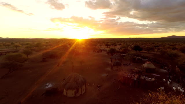 heli himba settlement at sunset - village stock videos & royalty-free footage