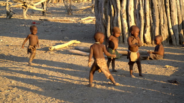 himba tribe- daily life in the village, namibia - traditional clothing stock videos & royalty-free footage