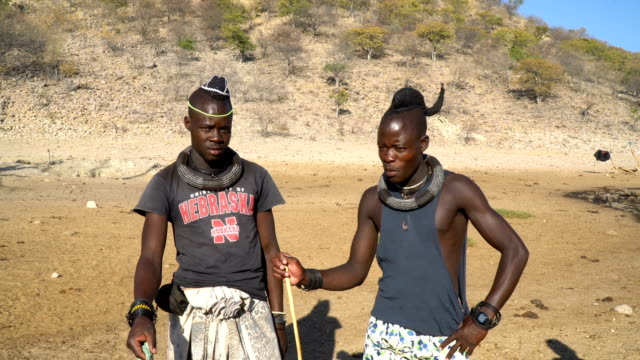 Himba tribe, Namibia- two young men with traditional hairstyle