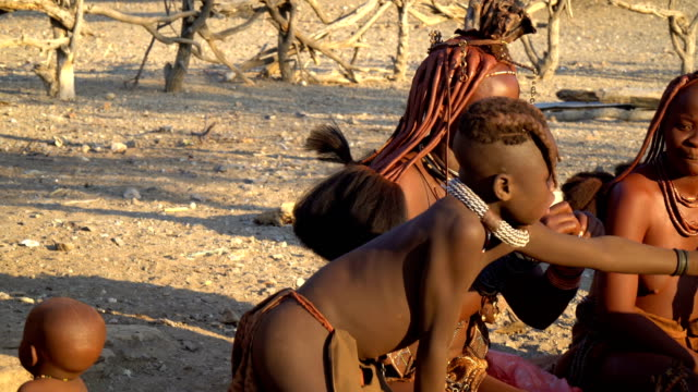 Himba tribe- woman and kids selling crafts  in the village, Namibia