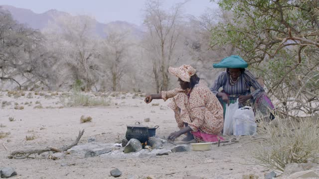 himba women cooking in desert, namibia, africa. real time. shot in 8k resolution. - 10 seconds or greater stock videos & royalty-free footage