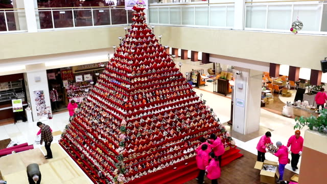 """""""hina"""" doll fans will be in seventh heaven at the sight of a 7-meter-high """"hinadan"""" pyramid--japan's tallest--set up at a mall here for hina matsuri,... - 800 meter stock videos & royalty-free footage"""