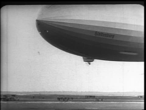 hindenburg descending during landing / anchor is dropped to ground / lakehurst nj - 1937 stock videos and b-roll footage