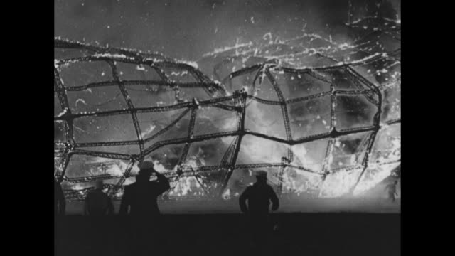 cu hindenburg exploding and burning and falling to ground crew on ground running away towards camera airship continues burning as it crashes flames... - airship stock videos & royalty-free footage