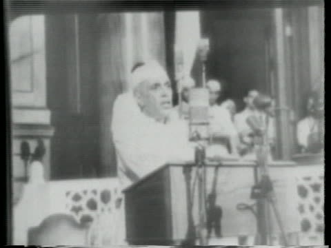 hindu crowds run through the streets of new delhi following the partition of india while the new prime minister, pandit nehru, gives a speech. - (war or terrorism or election or government or illness or news event or speech or politics or politician or conflict or military or extreme weather or business or economy) and not usa stock videos & royalty-free footage