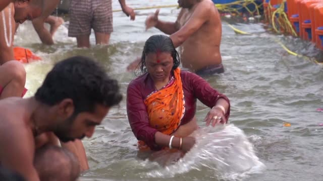 hindu devotees begin gathering in northern india for the world's largest religious festival with millions of pilgrims travelling to bathe in holy... - pellegrino video stock e b–roll