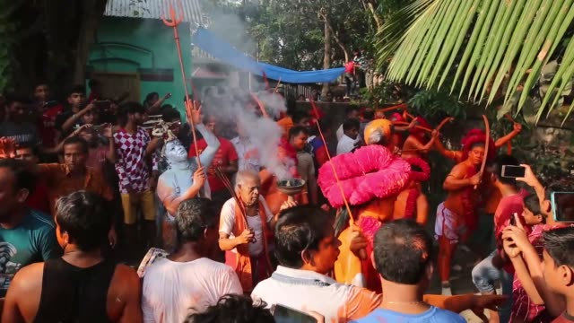 hindu devotees dance as they take part in a festival called lal kach during the last day of the bangla month in munshigonj, in dhaka, bangladesh on... - last day stock videos & royalty-free footage