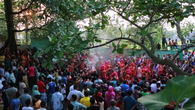 hindu devotees dance as they take part in a festival called lal kach during the last day of the bangla month in munshigonj in dhaka bangladesh on... - last day stock videos and b-roll footage