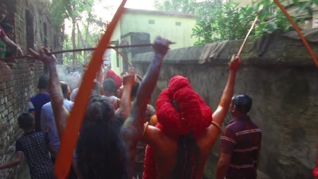 hindu devotees dance as they take part in a festival called lal kach during the last day of the bangla month in munshigonj in dhaka bangladesh on... - schlußtag stock-videos und b-roll-filmmaterial