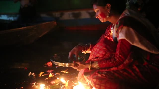 hindu devotees offer prayer hold lamps as they attend a ritual named bipodnashini puja that puja against evil and danger in old dhaka , bangladesh on... - traditional ceremony stock videos & royalty-free footage