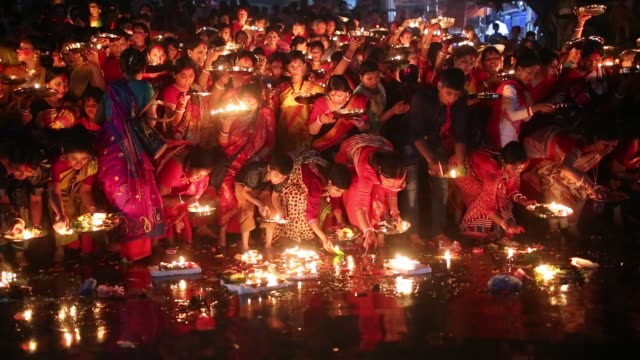 Hindu devotees offer prayer hold lamps as they attend a ritual named Bipodnashini Puja that Puja against evil and danger in old Dhaka Bangladesh on...