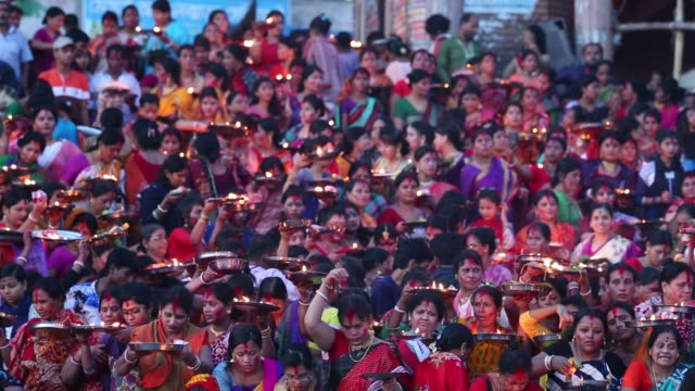 hindu devotees offer prayer hold lamps as they attend a ritual named bipodnashini puja that puja against evil and danger in old dhaka bangladesh on... - hinduism stock videos & royalty-free footage