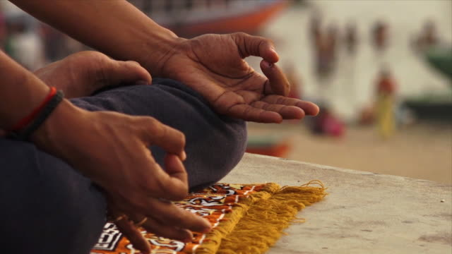 hindu man meditating at sunset, varanasi, ganga - worshipper stock videos & royalty-free footage