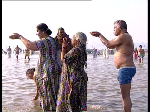 Hindu pilgrims bathe in the Ganges during the Maha Kumbh Mela