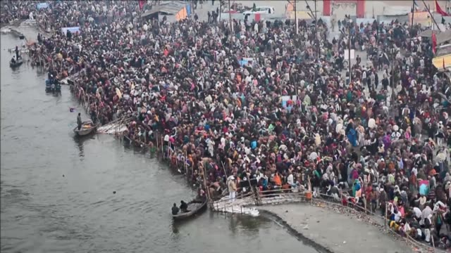 Hindu pilgrims gather at the confluence of the rivers of Ganges Yamuna and the mythical Saraswati to take a holy dip in the water during the annual...