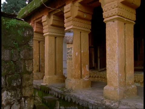 ms hindu priest walking out of temple, bandhavgarh national park, india - national icon stock videos & royalty-free footage