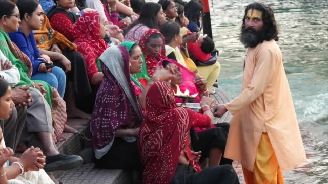 a hindu priests distributing the holy smoke / haridwar is an ancient city and important hindu pilgrimage site where the river ganges exits the... - foothills stock videos & royalty-free footage
