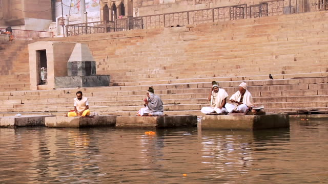ms hindu priests performing at ghat near ganges river / varanasi, uttar pradesh, india - holy book stock videos and b-roll footage