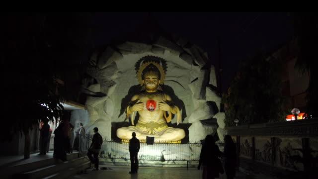 hindu statue at night - India