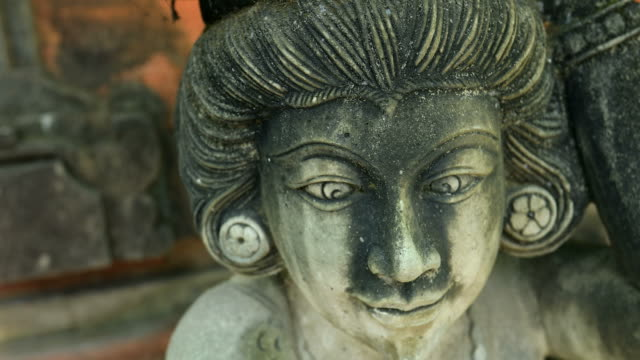 hindu statue in a bali temple in macro motion video - temple body part stock videos and b-roll footage