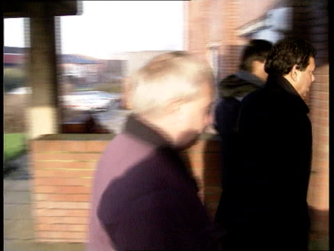west midlands: west bromwich: ext cms babu patel intvwd sof - worried this type of thing might spread police station: lms patel and others along l-r... - ウエストミッドランズ点の映像素材/bロール