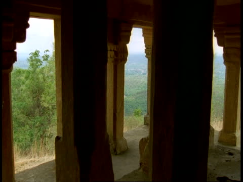 hindu temple pillars, zoom in to jungle in background, bandhavgarh national park, india - madhya pradesh stock videos and b-roll footage