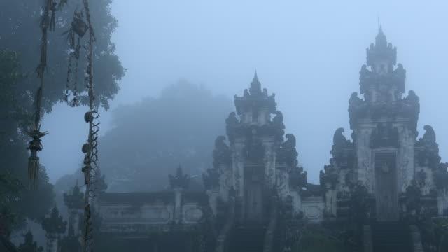 hindu temple pura lempuyang in the mist in bali - monument stock videos & royalty-free footage