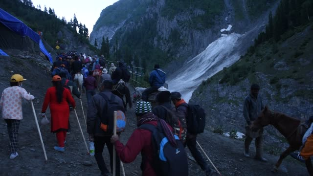 Hindu walk on mountain trails on foot ponies and are being carried in the palanquins as they make their pilgrimage to the sacred Amarnath Caves one...